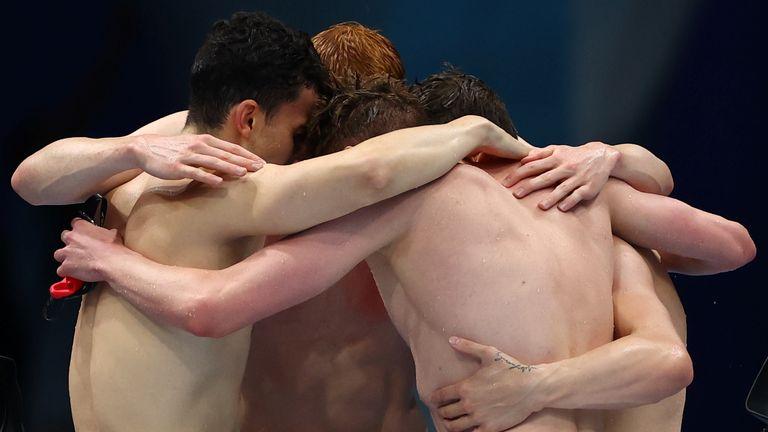 Tokyo 2020 Olympics - Swimming - Men's 4 x 200m Freestyle Relay - Final - Tokyo Aquatics Centre - Tokyo, Japan - July 28, 2021.Tom Dean of Britain, James Guy of Britain, Matthew Richards of Britain and Duncan Scott of Britain react after winning REUTERS/Kai Pfaffenbach