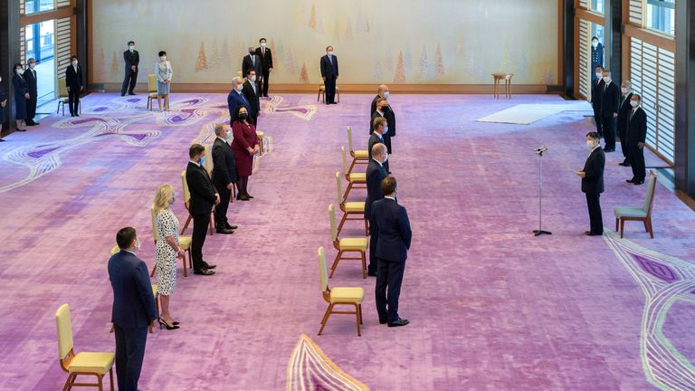 Japan's Emperor Naruhito met with foreign dignitaries at the Imperial Palace, including Emanuel Macron and Jill Biden, prior to the opening ceremony
