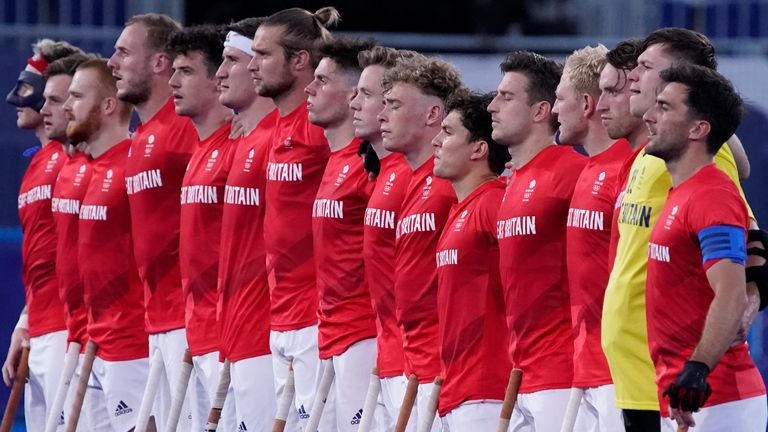 Great Britain line up during the national anthem before a men's field hockey match against South Africa at the 2020 Summer Olympics, Saturday, July 24, 2021, in Tokyo, Japan. (AP Photo/John Locher)