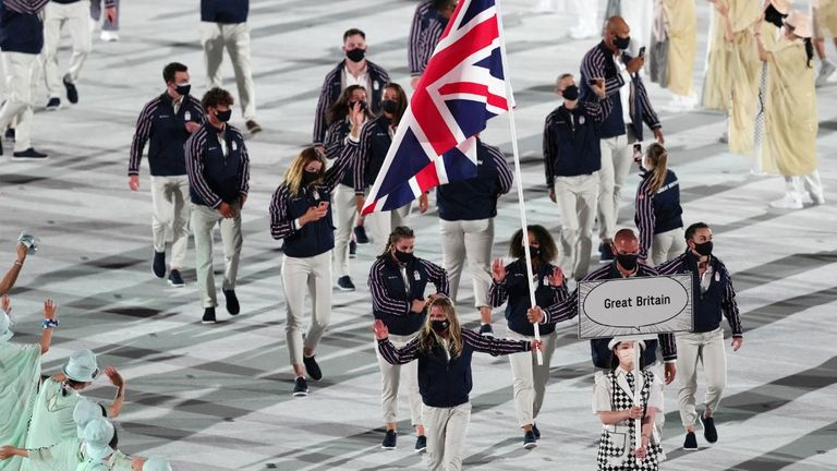 Great Britain flagbearers Hannah Mills and Mohamed Sbihi lead out the team during the opening ceremony of the Tokyo 2020 Olympic Games at the Olympic Stadium in Japan. Picture date: Friday July 23, 2021.