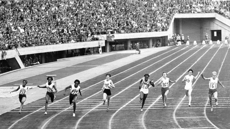 Tyus (third from left) finishing first in the 100m final in Tokyo