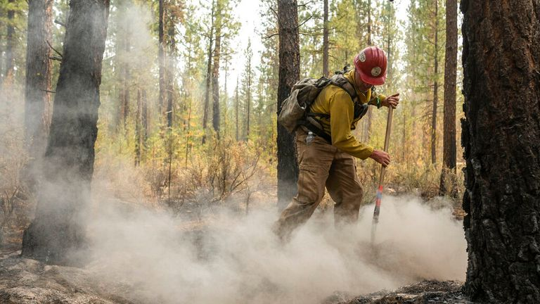 Firefighter Garrett Suza who is among crews battling to extinguish the Bootleg Fire in Oregon Pic: AP