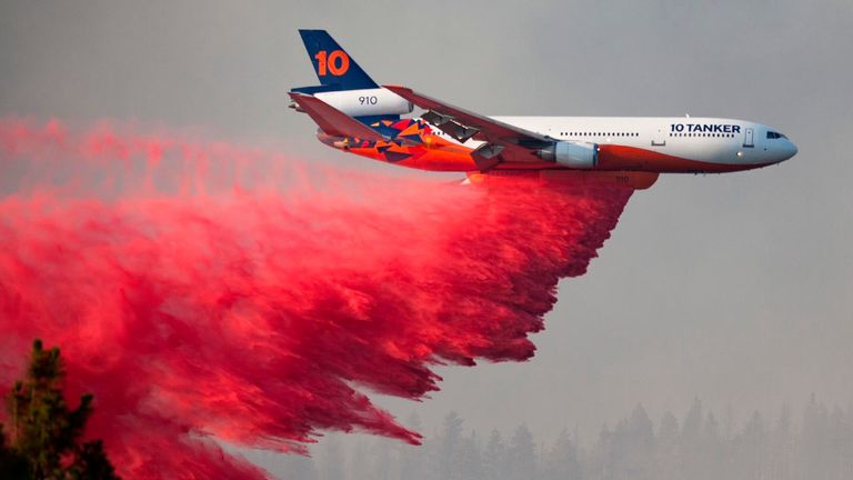 A plane drops retardant over the Bootleg fire, one of the largest wildfires in modern Oregon history