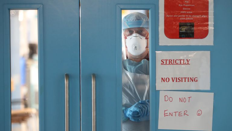 Infection control nurse Colin Clarke looking out from a Covid-19 recovery ward at Craigavon Area Hospital in Co Armagh, Northern Ireland