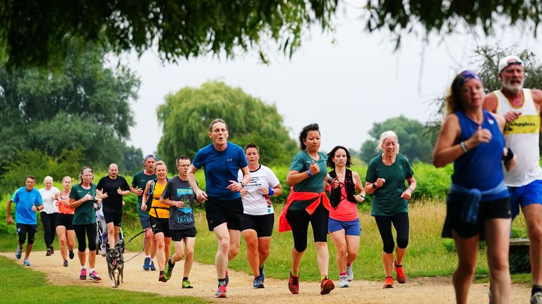 Runners taking part in the Parkrun at Bushy Park in London