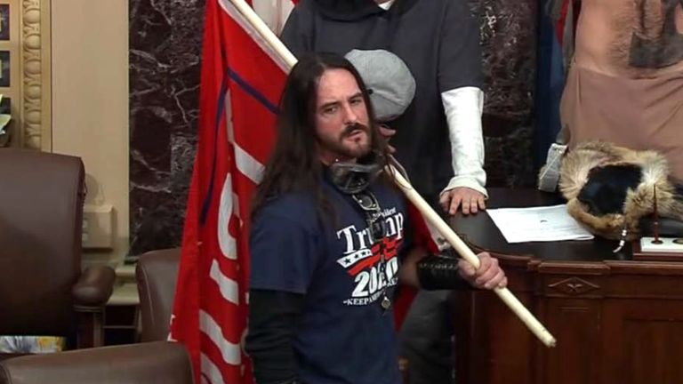 Paul Allard Hodgkins on the floor of the US Senate on 6 January (US Capitol Police via AP)