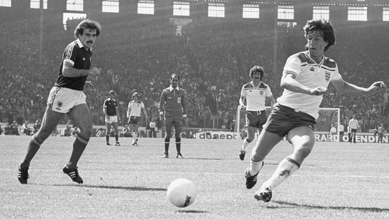 Soccer - 1980 British Home Championship - Scotland v England - Hampden Park England's Paul Mariner (c) in action with Scotland's Willie Miller (l). The Referee in the back ground is Antonio Jose da Silva Garrido from Portugal. Read less