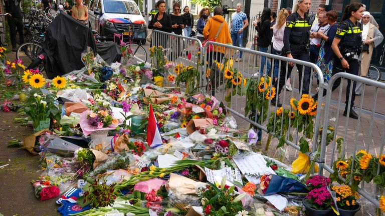 Floral tributes at the spot where journalist  Peter R. de Vries was shot in Amsterdam Pic: AP