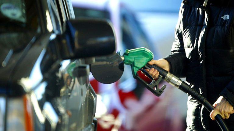 A Person fills fuel at a petrol pump in Liverpool