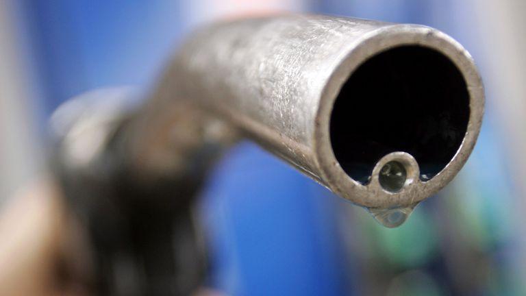 A motorist holds a fuel pump