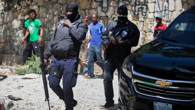 Security forces in Port-au-Prince outside President Jovenel Moise's home. Pic: Associated Press