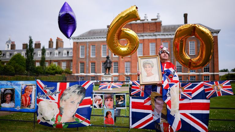 Royal fan John Loughrey poses for a picture outside Kensington Palace, before the installation of a statue in honour of Princess Diana, in London, Britain, July 1, 2021. REUTERS/John Sibley