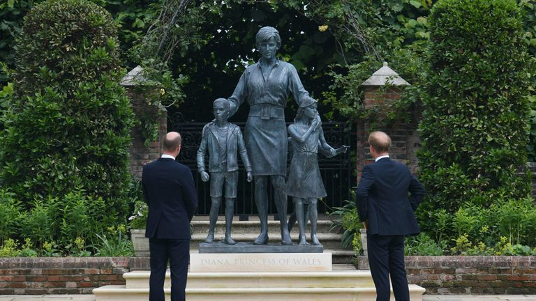 Britain's Prince William and Prince Harry look at the staue they commissioned of their mother Princess Diana, on what woud have been her 60th birthday, in the Sunken Garden at Kensington Palace, London, Thursday July 1, 2021. (Dominic Lipinski /Pool Photo via AP)