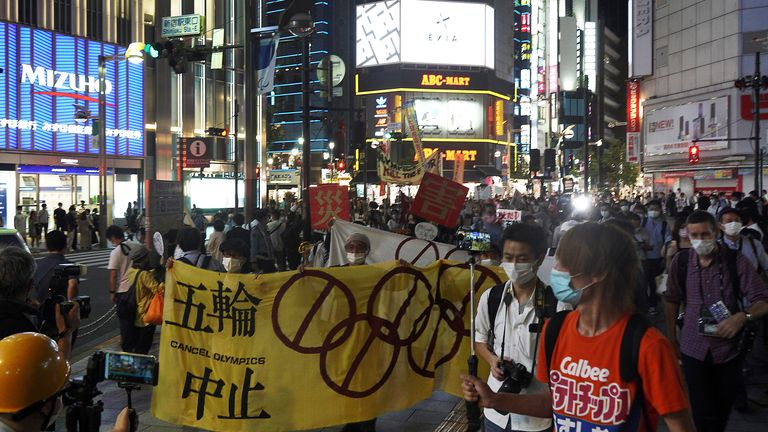 People who are against the Tokyo 2020 Olympics set to open in July, march to protest in Shinjuku district during an anti-Olympics demonstration Wednesday, June 23, 2021, in Tokyo. (AP Photo/Kantaro Komiya)