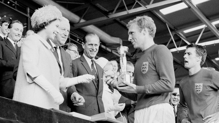 The Queen presents the World Cup to England captain Bobby Moore in 1966
