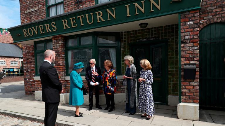 Queen Elizabeth II meets actors (left to right)William Roache, Barbara Knox, Sue Nicholls and Helen Worth, during a visit to the set of Coronation Street
