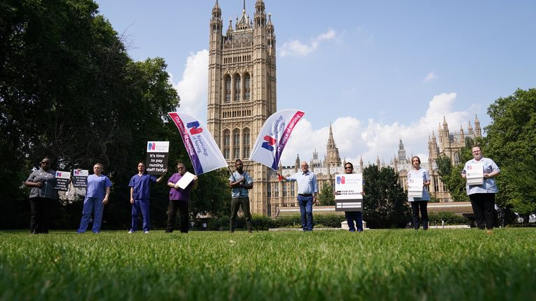 Nurses with placards outside the Royal College of Nursing (RCN) in Victoria Tower Gardens, London. The Government has come under attack for failing to announce an expected pay rise for NHS staff in England. Picture date: Wednesday July 21, 2021.