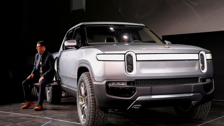 Rivian's CEO with the company's R1T all-electric pickup truck