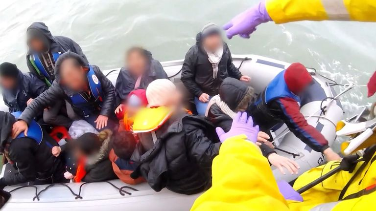 Editors please note - footage blurred at source Screengrab taken from handout bodyworn footage taken in November 2019 issued by the Royal National Lifeboat Institution (RNLI) showing a dinghy full of migrants being rescued by the RNLI in the English Channel. The clip shows around 12 people in a small inflatable being pulled to safety by lifeboat volunteers, and include a baby and at least one other child. Issue date: Wednesday July 28, 2021.