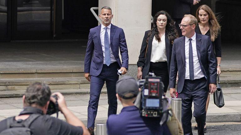 Former Manchester United footballer Ryan Giggs (centre) leaves Manchester Crown Court where he pleaded not guilty to assaulting two women and controlling or coercive behaviour. Picture date: Friday July 23, 2021.