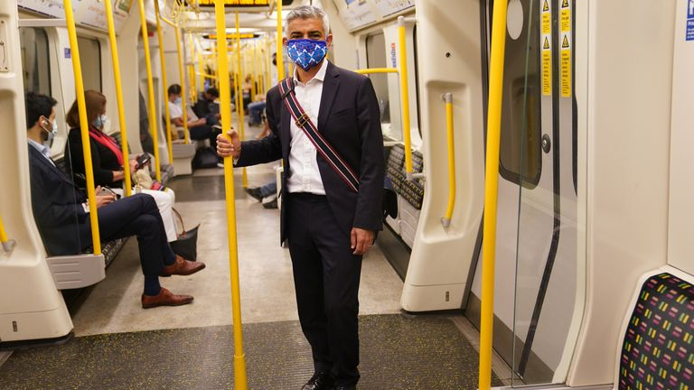 Mayor of London Sadiq Khan wears a face covering as he travels on the Tube