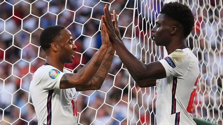 Sterling and Saka celebrate the equaliser