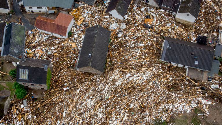 Trees and other detritus were left between houses in Schuld. Pic: Associated Press