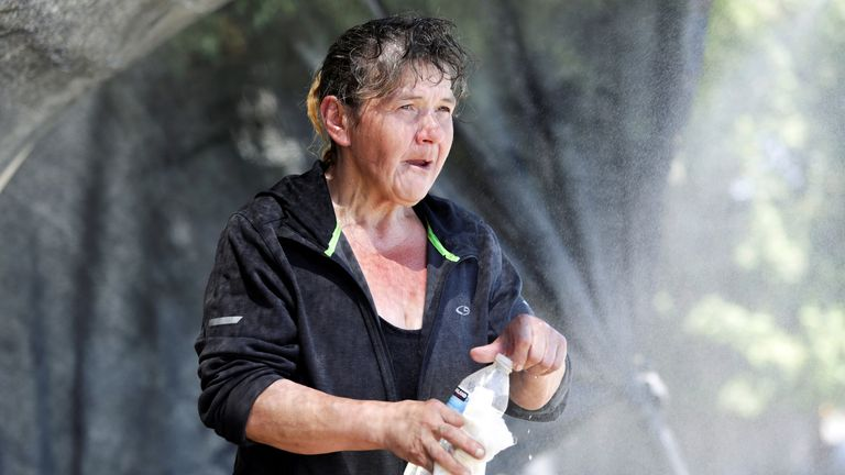 A woman cools off during the heatwave in Seattle, Washington