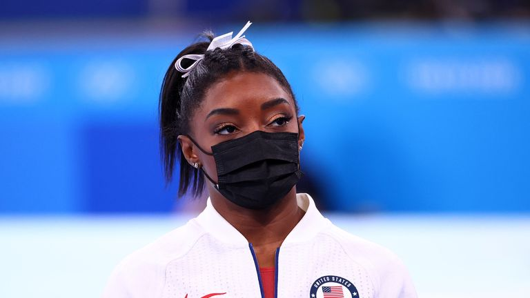 Tokyo 2020 Olympics - Gymnastics - Artistic - Women's Team - Final - Ariake Gymnastics Centre, Tokyo, Japan - July 27, 2021. Simone Biles of the United States wearing a protective face mask looks on. REUTERS/Lindsey Wasson