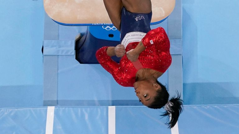 Simone Biles in mid-flight during her ill-fated vault performance in the women's artistic gymnastics team final. Pic: AP