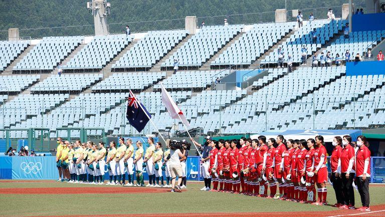 Jul 21, 2021; Fukushima, Japan; Japan and Australia line up for their national anthems before a softball opening round game during the Tokyo 2020 Olympic Summer Games at Fukushima Azuma Stadium. Mandatory Credit: Yukihito Taguchi-USA TODAY Network
