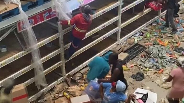 Looting in a warehouse in South Africa
