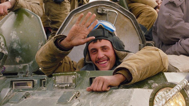 ** FILE ** A smile and a wave from a happy Soviet soldier, as his armoured convoy makes its way back to the Soviet Union along a north Afghanistan highway in this Sunday, Feb. 7, 1989, file photo. The Soviet Union lost some 15,000 soldiers in the war, which began in 1979 when Moscow sent in troops to battle guerrillas who were fighting a Soviet-supported government.  (AP Photo/Boris Yurchenko, File)