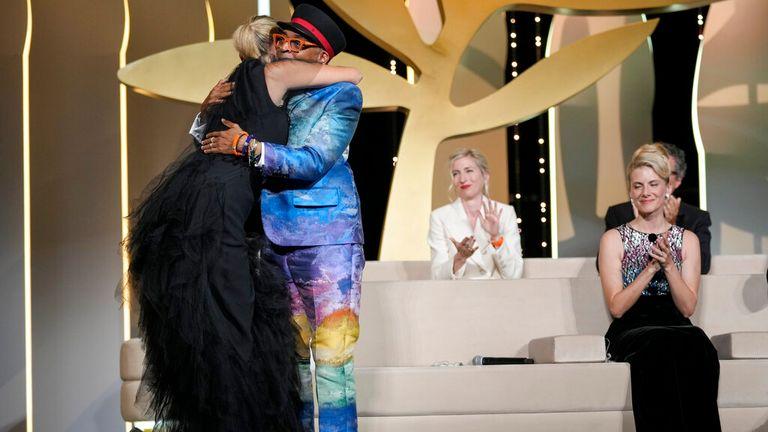 Julia Ducournau hugs jury president Spike Lee after winning the Palme d'Or