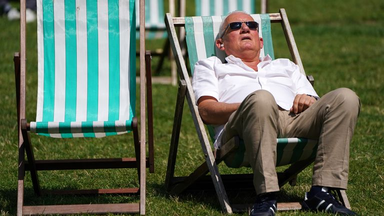 A Sunbather lounges on a deck chair in Green Park, London. Picture date: Saturday July 17, 2021.