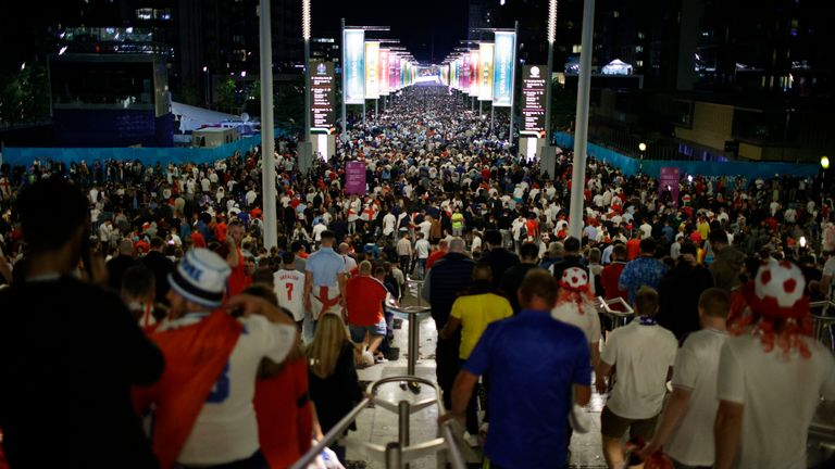 Supporters leave Wembley Stadium after England lost to Italy in the Euro 2020 final