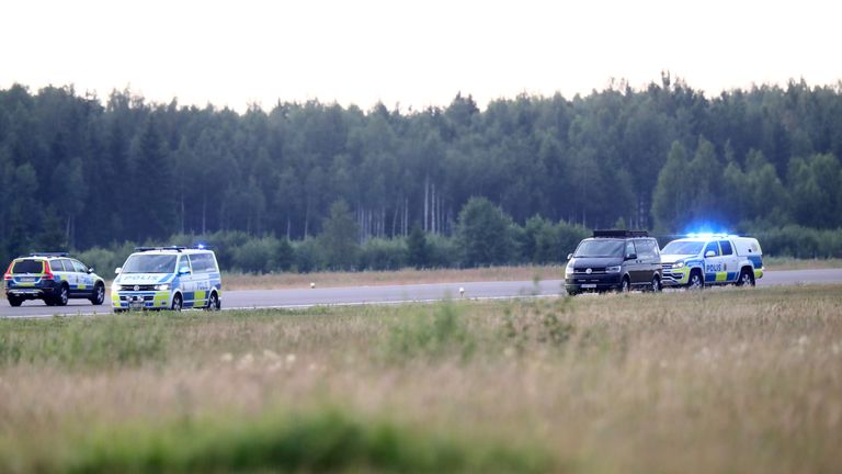 Police vehicles at the scene of the crash in Sweden