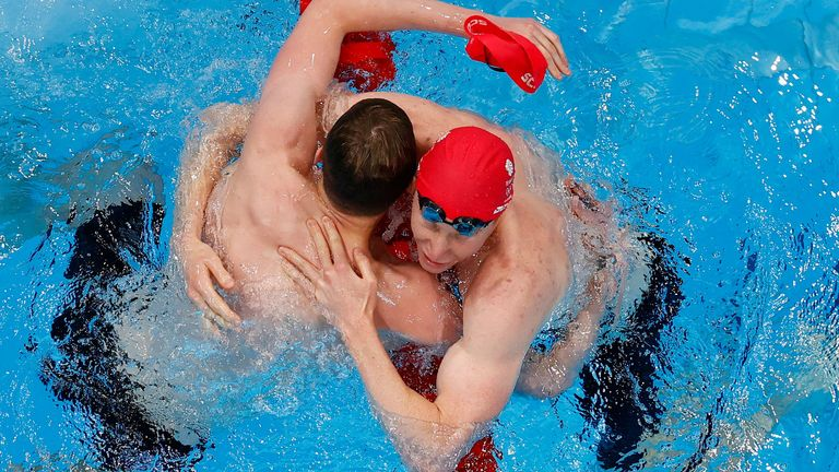 Tom Dean of Britain and Duncan Scott of Britain celebrate after winning gold and silver