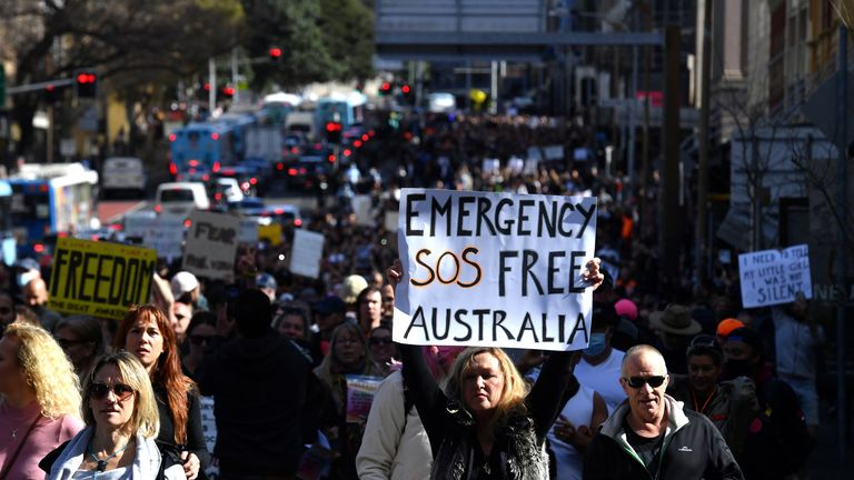 Protesters march through the city centre during an anti-lockdown rally as an outbreak of the coronavirus disease (COVID-19) affects Sydney, Australia, July 24, 2021. AAP Image/Mick Tsikas via REUTERS ATTENTION EDITORS - THIS IMAGE WAS PROVIDED BY A THIRD PARTY. NO RESALES. NO ARCHIVE. AUSTRALIA OUT. NEW ZEALAND OUT