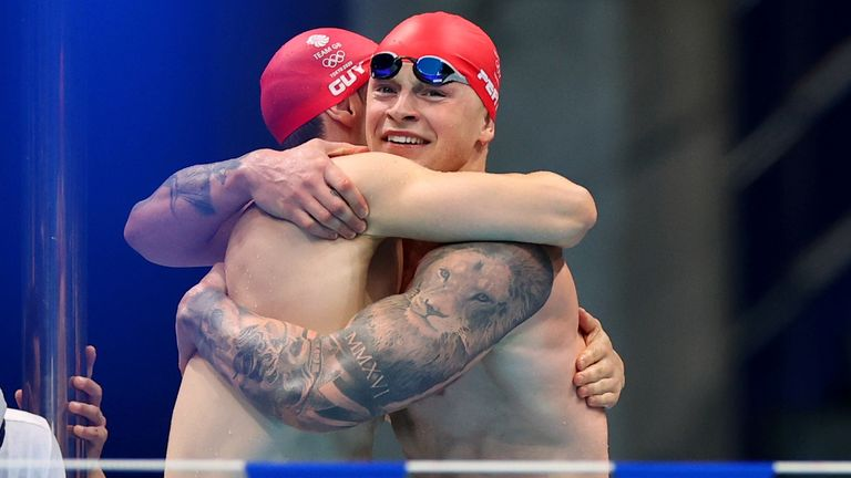 Guy and Peaty celebrate after being part of the team that cemented a new world record in the 4x100m medley relay