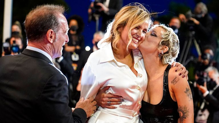 Julia Ducournau (R) with Agathe Rousselle and Vincent Lindon at the Titane premiere at Cannes