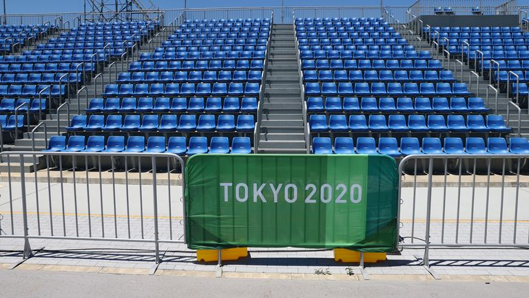 Tokyo 2020 Olympics - Rowing Training Sessions - Sea Forest Waterway, Tokyo, Japan - July 18, 2021 General view of seats and Tokyo 2020 Olympics signage REUTERS/Thomas Peter
