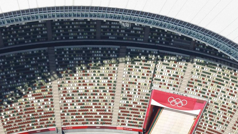 In this aerial photo, the Olympic Rings are seen with spectators' seats at the National Stadium in Tokyo Japan, Monday, June 21, 2021. .(Kyodo News via AP)