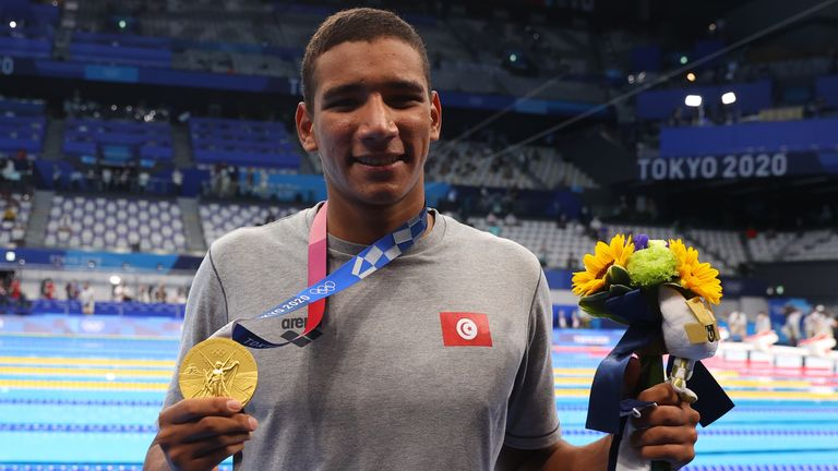 Ahmed Hafnaoui of Tunisia poses with the gold medal