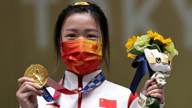 Shooter Yang Qian of China claimed the first gold medal of the Olympics