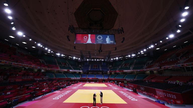 Tokyo 2020 Olympics - Judo - Training Sessions - Nippon Budokan, Tokyo, Japan - July 22, 2021. Technicians work on the mat in Nippon Budokan Arena, during training sessions. REUTERS/Sergio Perez