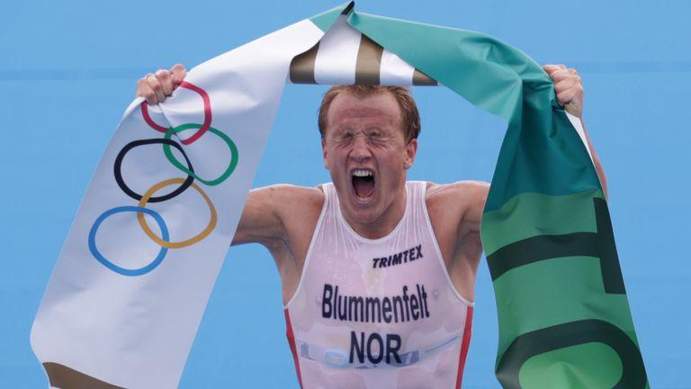 Norway's Kristian Blummenfelt celebrates his gold at the finish line