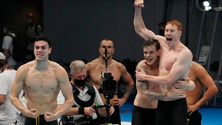 Tom Dean (right) celebrates a second gold in the pool, this time in the 4x200 freestyle