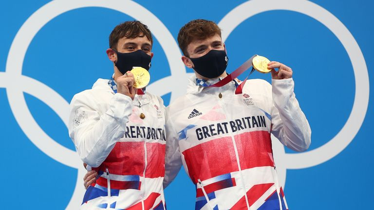 Tom Daley and Matty Lee pose with their gold medals