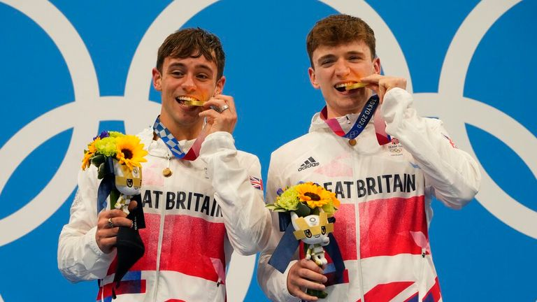 Thomas Daley and Matty Lee of Britain pose for a photo after winning gold medals during the men's synchronized 10m platform diving final at the Tokyo Aquatics Centre at the 2020 Summer Olympics, Monday, July 26, 2021, in Tokyo, Japan. (AP Photo/Dmitri Lovetsky)